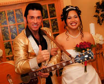 Guitar in hand, Elvis impersonator escorts bride down the aisle to meet her soon-to-be husband.