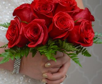 12 rose hand tied bridal bouquet with fresh red roses.