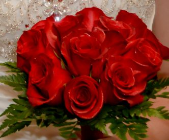12 rose hand tied bridal bouquet with bright red roses.