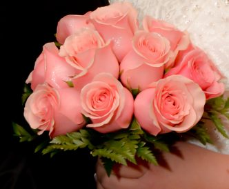 12 rose hand tied bridal bouquet with pink roses.