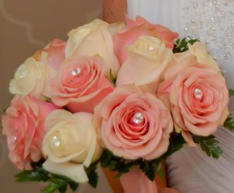 12 rose hand tied bridal bouquet with pink and white roses.