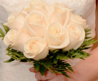 12 rose hand tied bridal bouquet with fresh white roses.