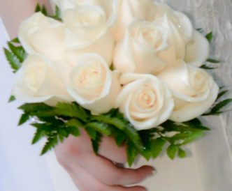 12 rose hand tied bridal bouquet with white roses.