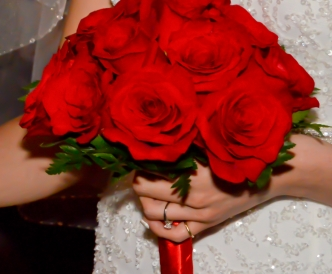 12 rose hand tied bridal bouquet with red roses.