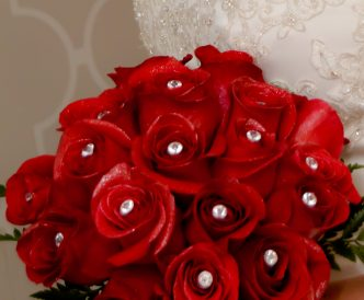 18 rose hand tied bridal bouquet with red roses.