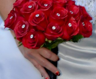 18 rose hand tied bridal bouquet with fresh red roses.