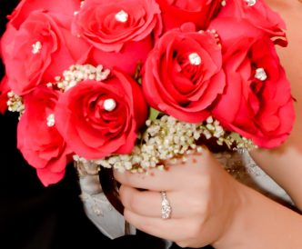 18 rose hand tied bridal bouquet with light red roses.