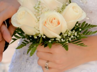 6 rose hand tied bridal bouquet with white roses.