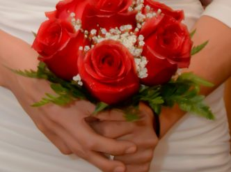 6 rose hand tied bridal bouquet with red roses.