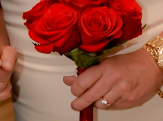 6 rose hand tied bridal bouquet with fresh red roses.