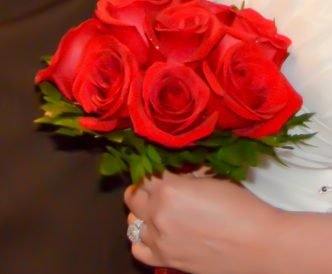 9 rose hand tied bridal bouquet with fresh red roses.