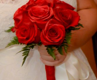 9 rose hand tied bridal bouquet with red roses.