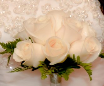 9 rose hand tied bridal bouquet with fresh white roses.