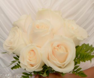 9 rose hand tied bridal bouquet with bright white roses.