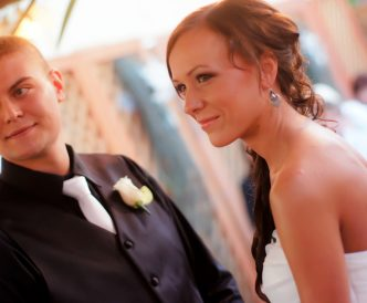 Candid wedding photography: smiling, emotional couple in love exchange vows outdoors in the Gazebo.