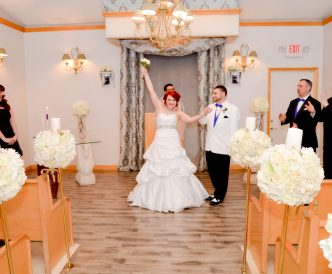 Candid wedding photography: bride celebrates officially being married in wedding chapel.