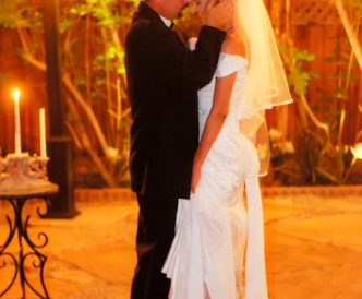 Candid wedding photography: newlyweds first dance outdoors in Gazebo.