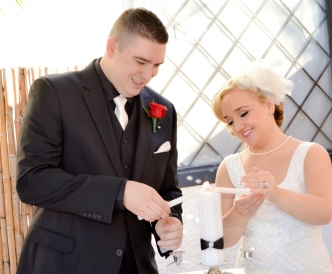 Candid wedding photography: outdoor unity candle ceremony with young couple in the Pavilion.