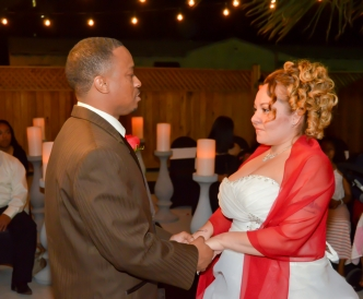 Candid wedding photography: bride and groom exchange vows outdoors in the Pavilion.