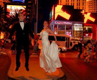 Neon Boneyard Wedding Photography: couple leaps for joy.