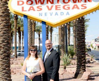 Neon Boneyard Wedding Photography: newlyweds by Welcome sign.