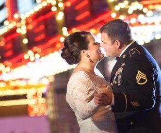 Neon Boneyard Wedding Photography: kiss beneath the bright lights at night.