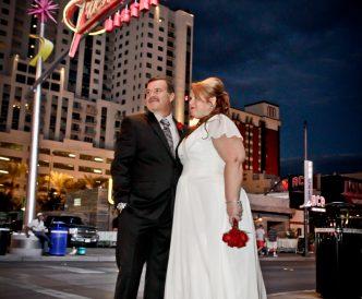 Neon Boneyard Wedding Photography: standing by the street lights.