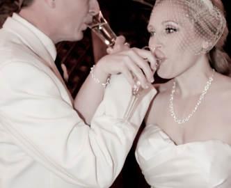 Bride and groom toast their marriage.
