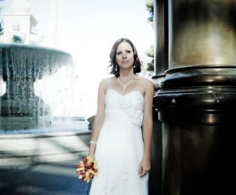 Wedding photography on the Vegas Strip: bride at fountain.