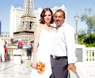 Wedding photography on the Vegas Strip: bride and groom by Paris Hotel in the afternoon.