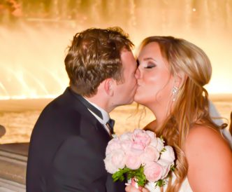 Wedding photography on the Vegas Strip: kiss in front of the famous water fountains.