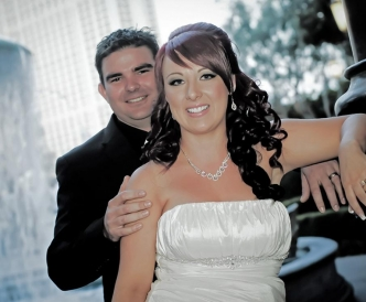 Wedding photography on the Vegas Strip: happy couple by falling water.