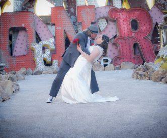Neon Boneyard Wedding Photography: dip kiss.