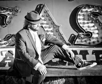 Neon Boneyard Wedding Photography: groom black and white.