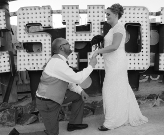 Neon Boneyard Wedding Photography: black and white, groom kisses bride's hand.