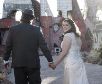 Neon Boneyard Wedding Photography: bride and groom enter the museum hand in hand.