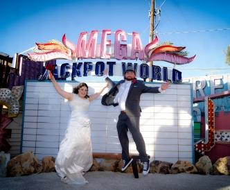 Neon Boneyard Wedding Photography: leaping newlyweds.