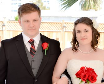 Couple during wedding ceremony in Le Pavilion outdoor venue on the Las Vegas Strip.
