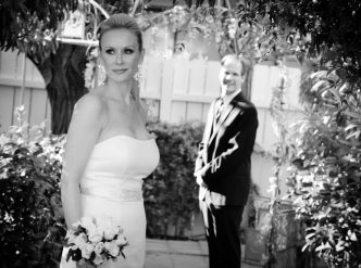 Posed wedding photography: garden bride and groom in black and white.