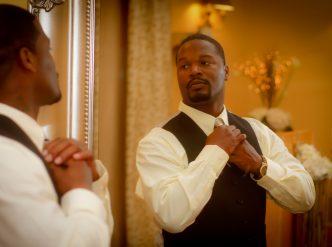 Posed wedding photography: handsome groom prepares.
