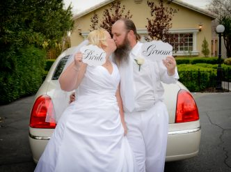 Posed wedding photography: just married wedding limo.