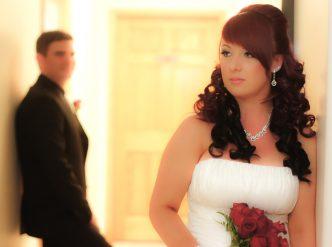 Posed wedding photography: bridal first look as groom sneaks a peak.