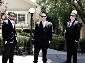 Posed wedding photography: groomsmen outside chapel.