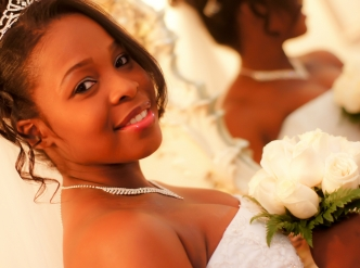 Posed wedding photography: bride with bouquet.