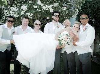 Posed wedding photography: groomsmen lift the bride.