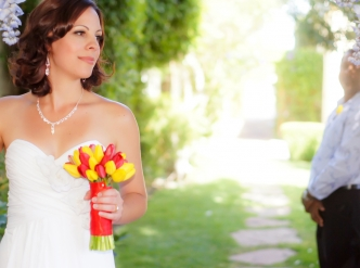 Posed wedding photography: soft lens bride and groom in chapel garden.