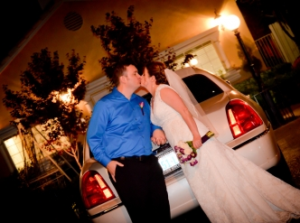 Posed wedding photography: a kiss in front of the wedding chapel.