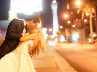 Posed wedding photography: a kiss on Las Vegas Boulevard.