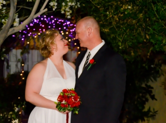 Posed wedding photography: nighttime garden.