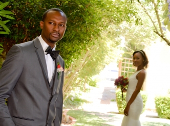 Posed wedding photography: classic bride and groom in garden.